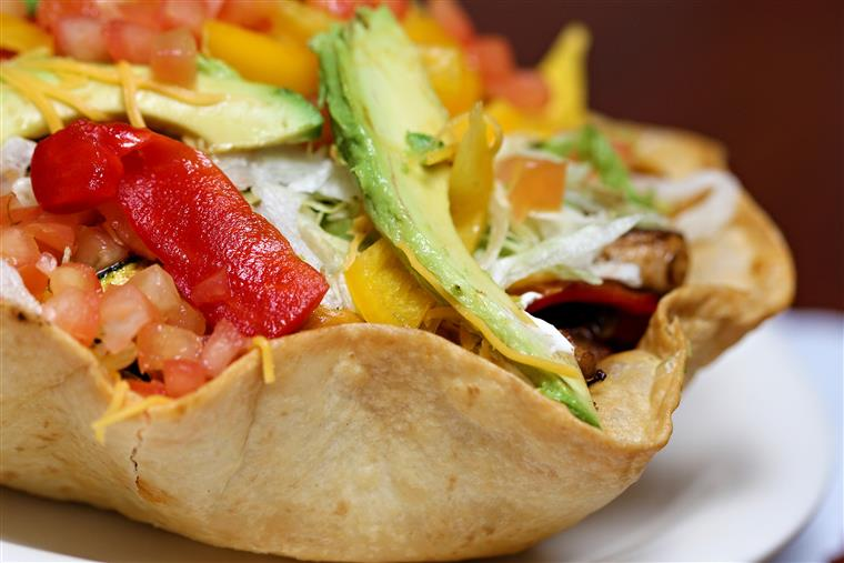 Taco salad close up in a tortilla shell.