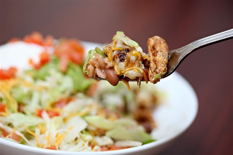 Tostada Bowl. Refried beans, House meat, cheese, lettuce, tomato, guacamole and sour cream.