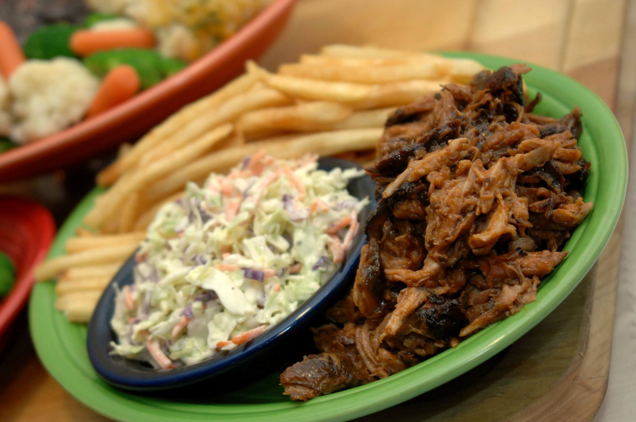 Pulled pork combo plate with coleslaw and French fries