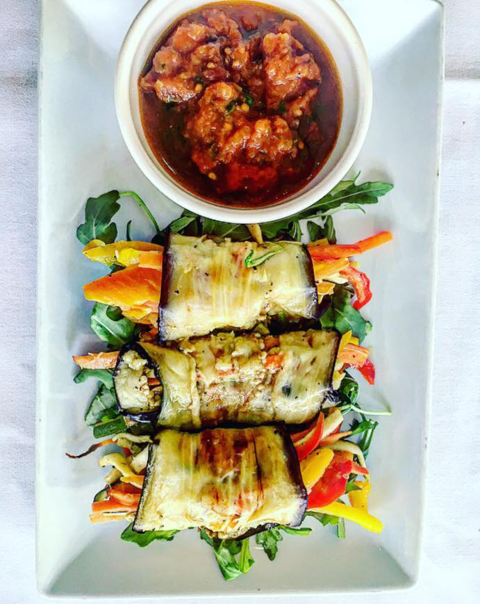 Eggplant rolled veggies with a side of soy dipping sauce
