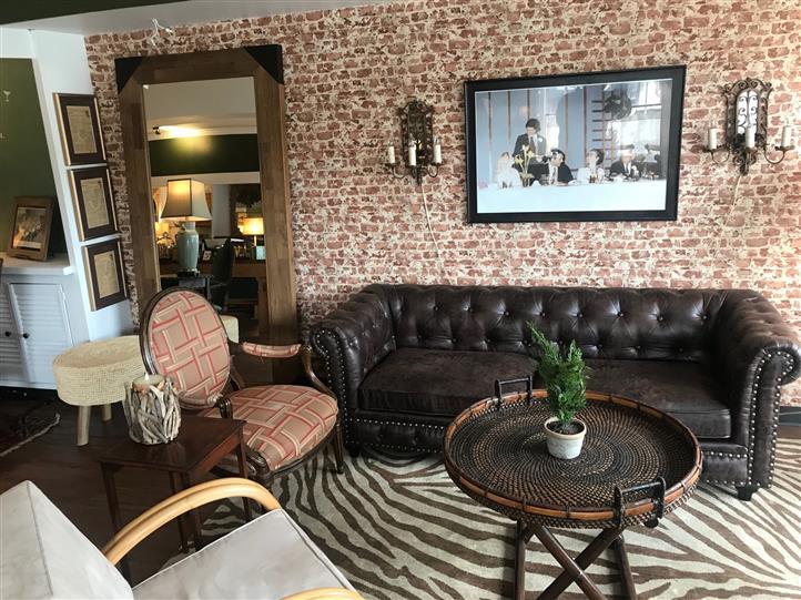 brick wall with couch and decorated