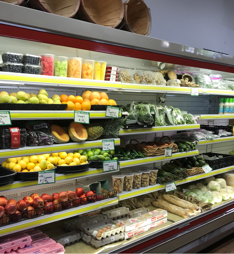 shelves filled with fresh produce such as vegetables
