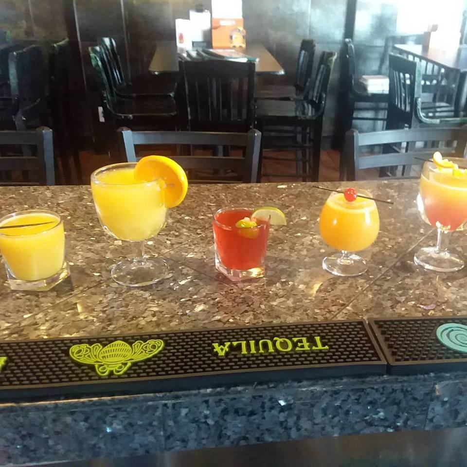 Assorted cocktails on a bar-top