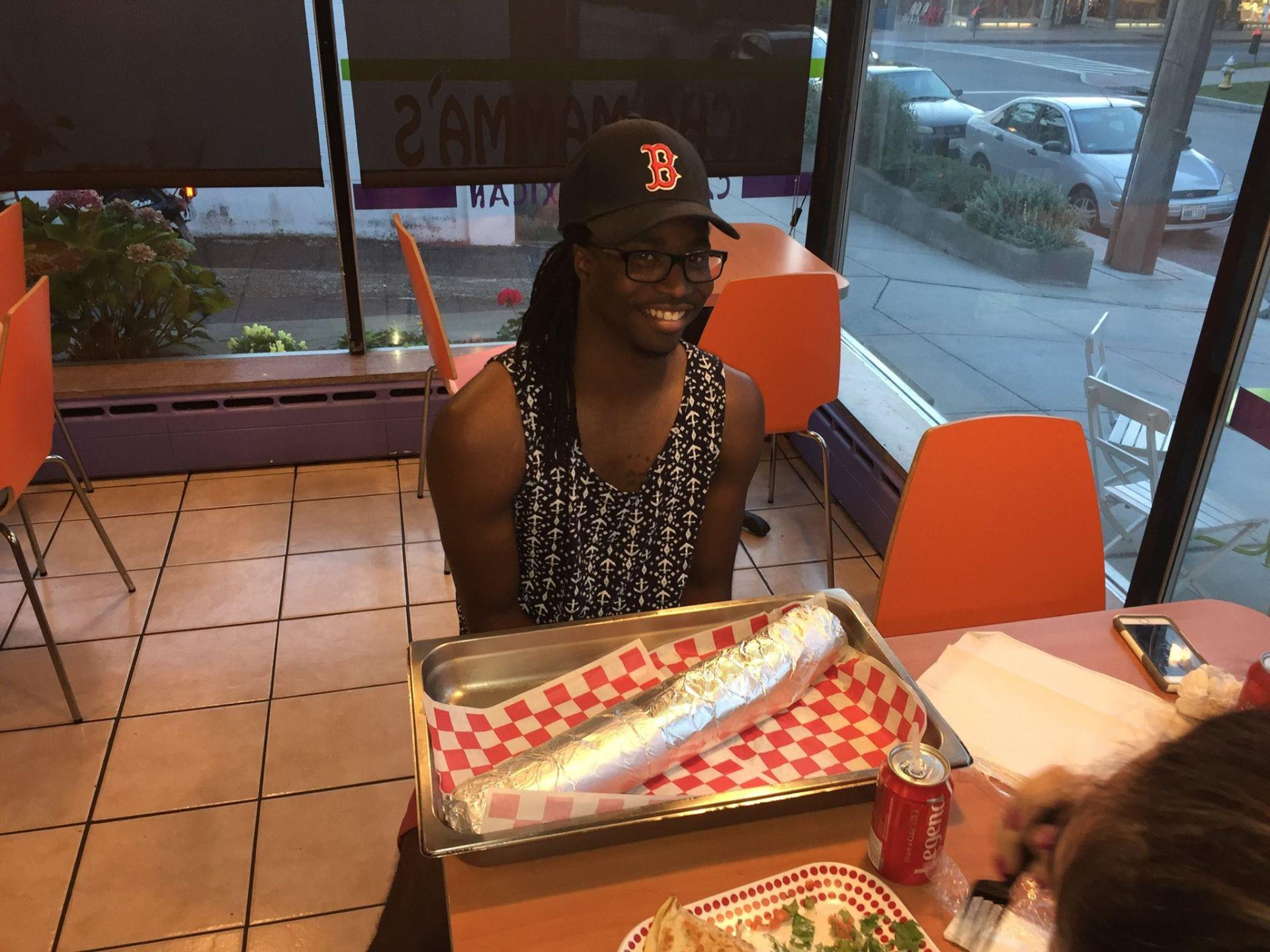 Customer sitting at a table ready for the burrito challenge