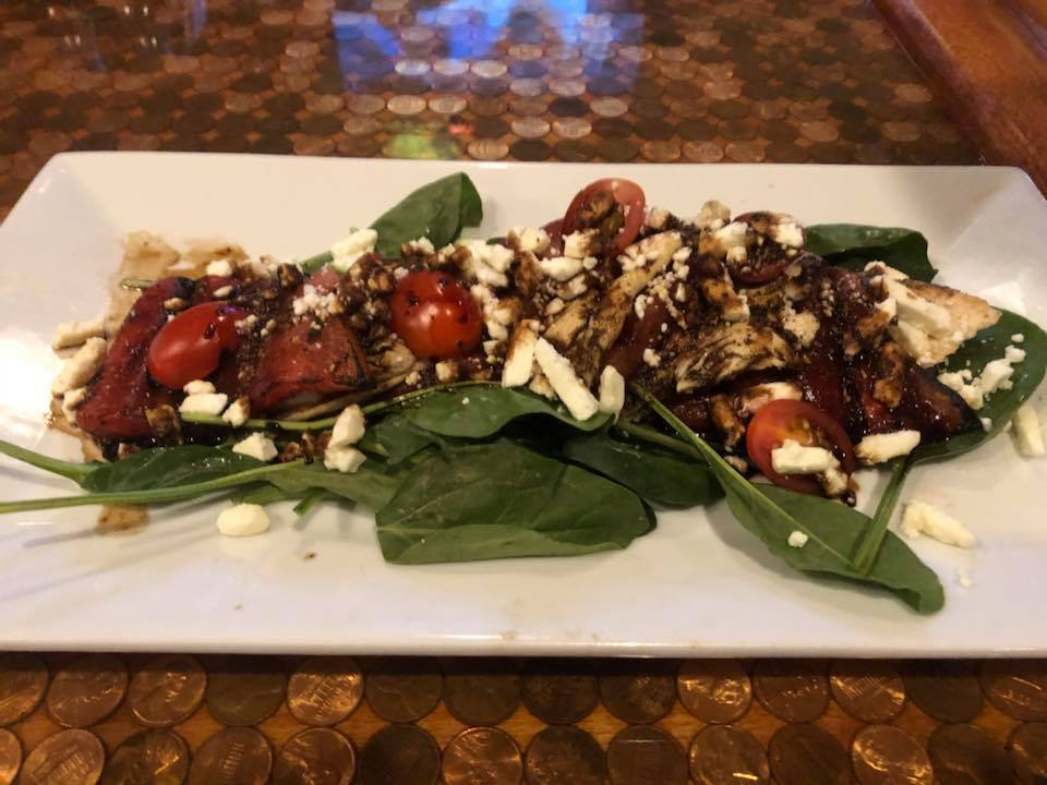 spinach salad with tomatoes, feta cheese and balsamic dressing