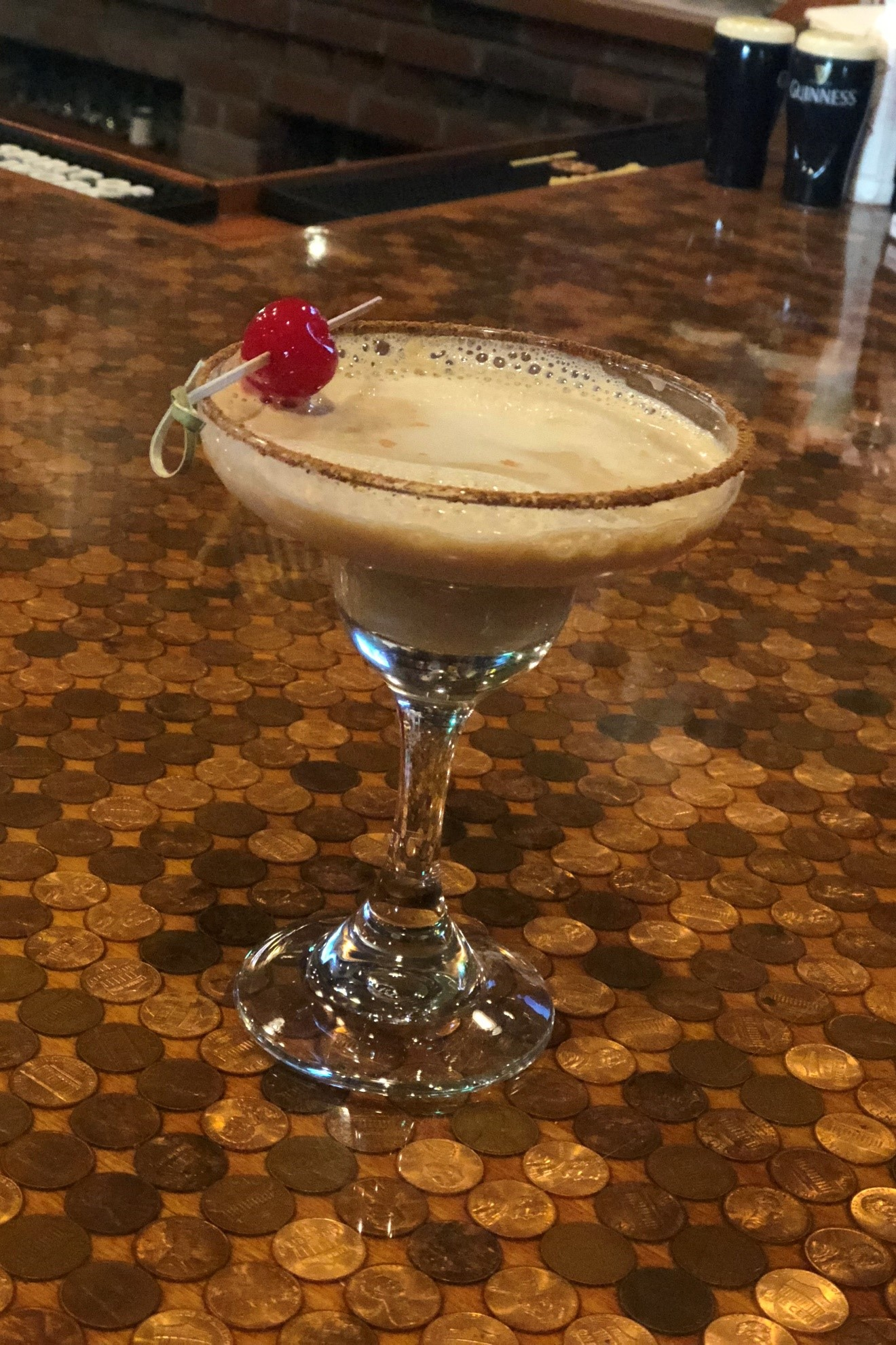 chocolate martini topped with a cherry