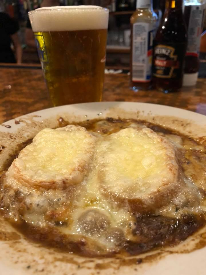 french onion soup topped with two large croutons and melted cheese