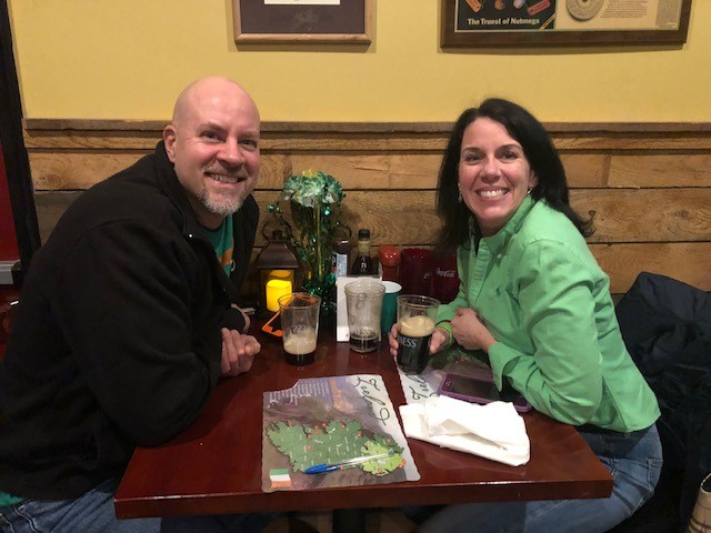 couple sitting at a table decorated for st patricks day