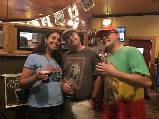 friends at a bar with drinks