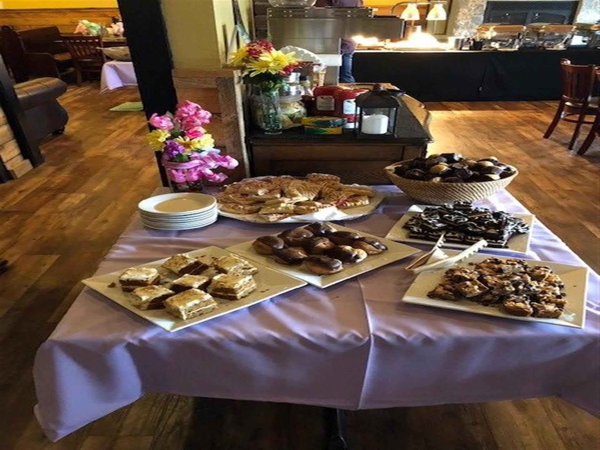 dessert platters on a table with purple tablecloth