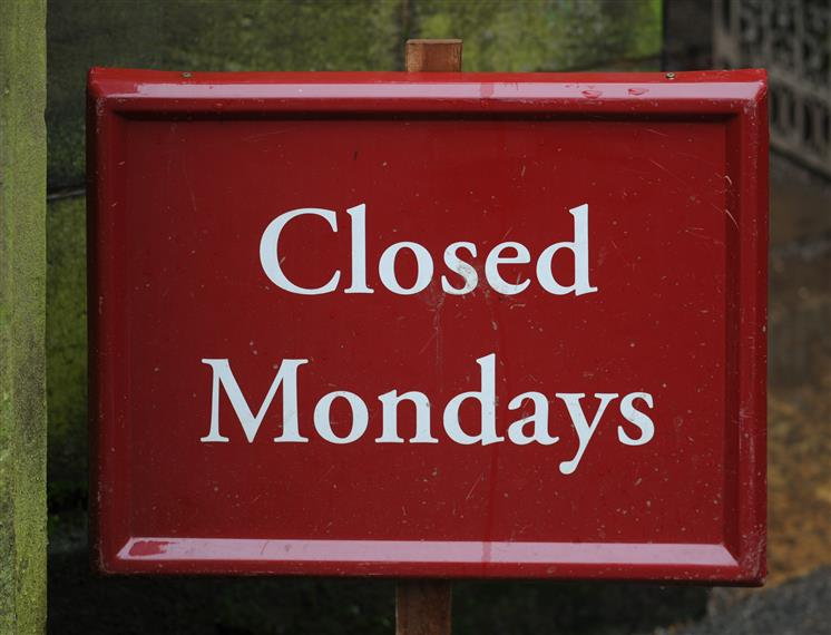 Sign that says closed on mondays