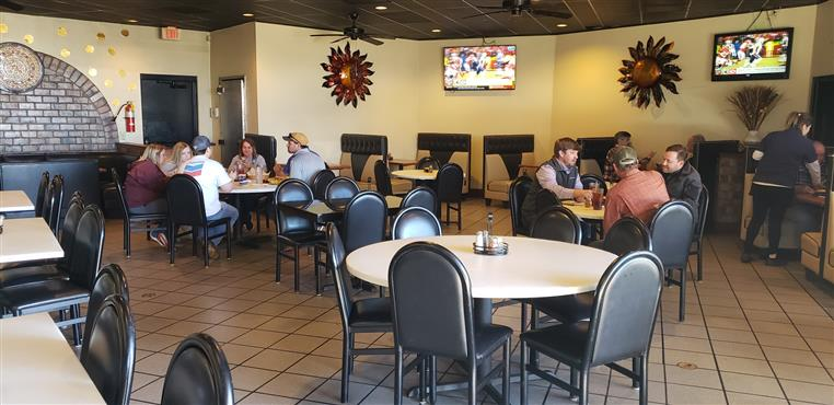 Interior dining area with tables of customers