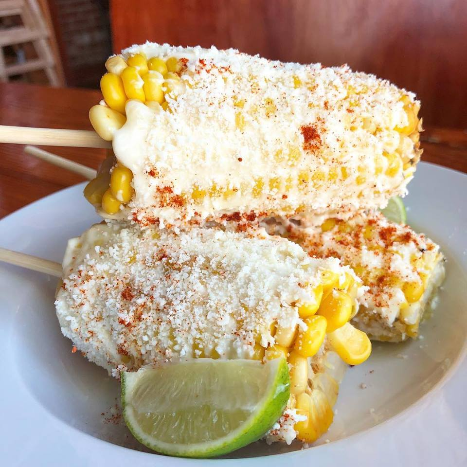 Street corn covered with mayo, chili powder, cotija cheese and lime