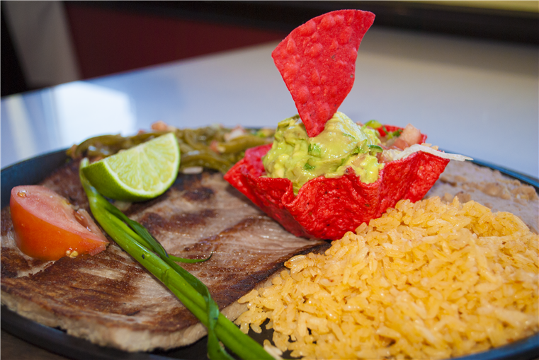 Carne Asada served with rice and guacamole