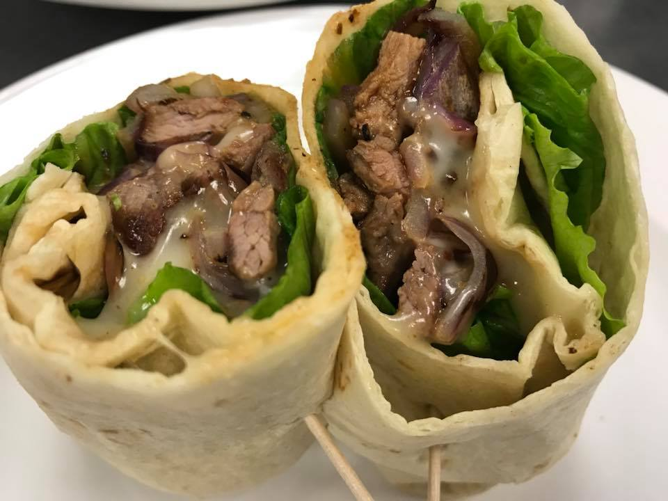 Skirt steak and cheese wrap with lettuce
