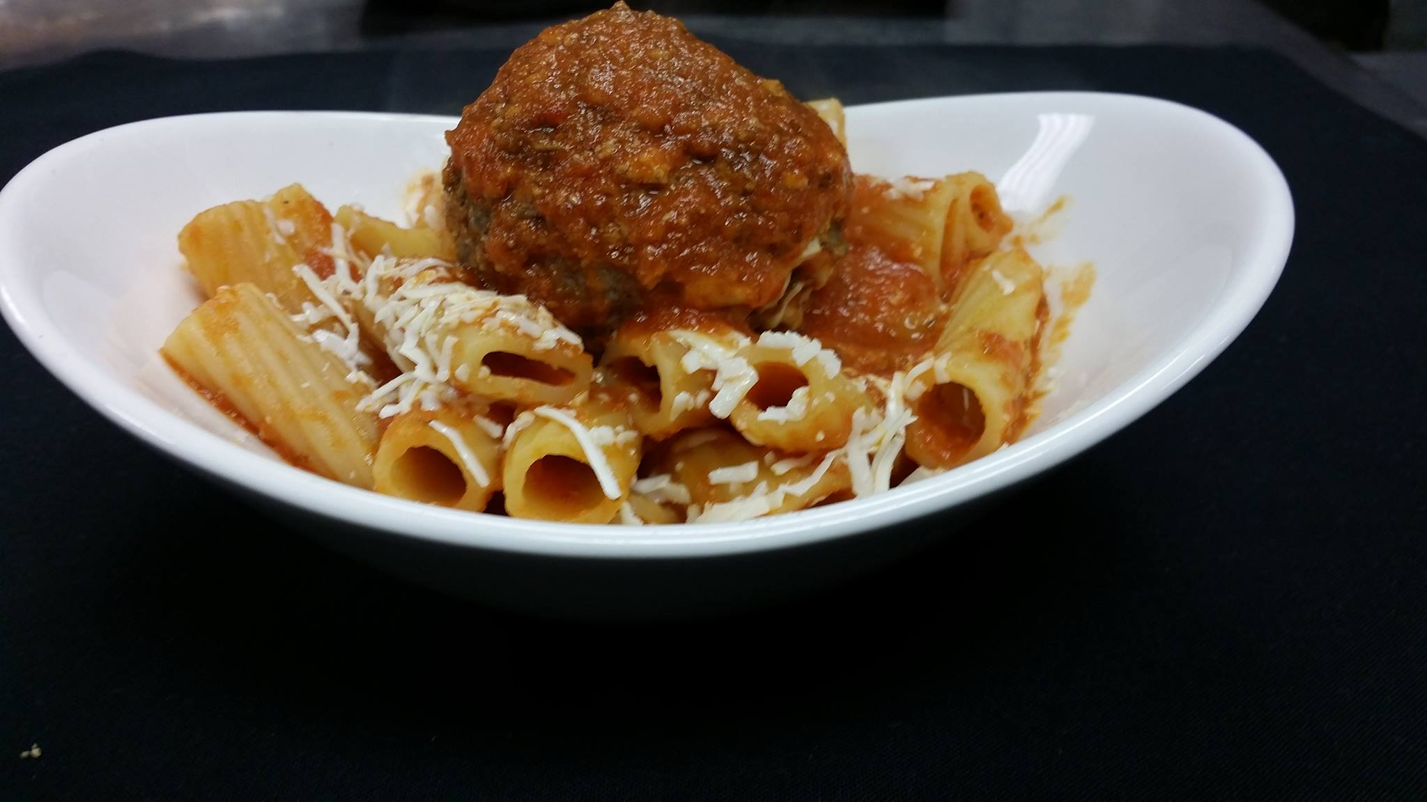 Rigatoni pasta with tomato sauce and meatball