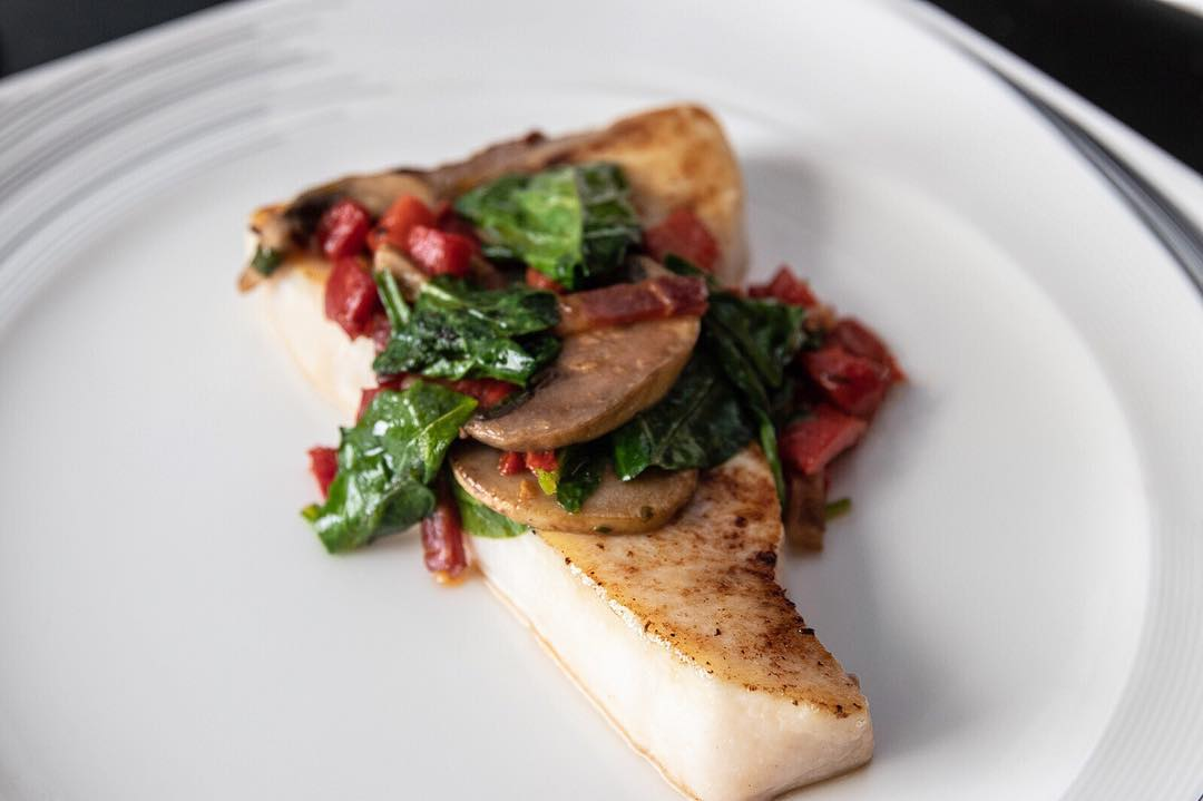 Swordfish steak with spinach and sun dried tomatoes
