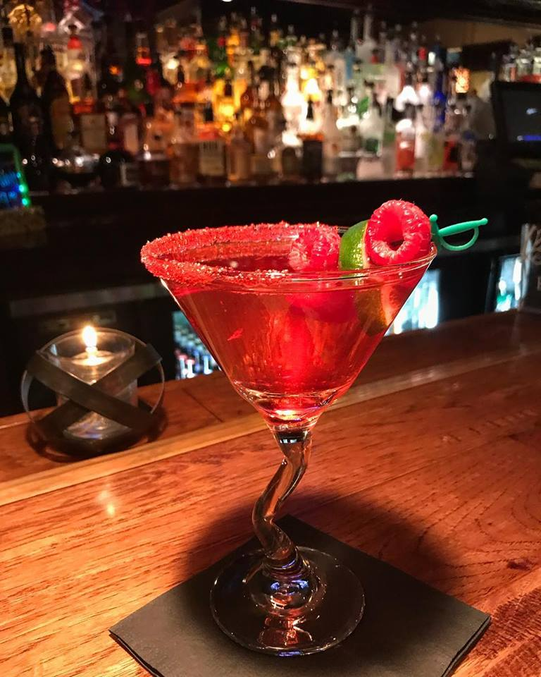 Raspberry cocktail on a bar-top