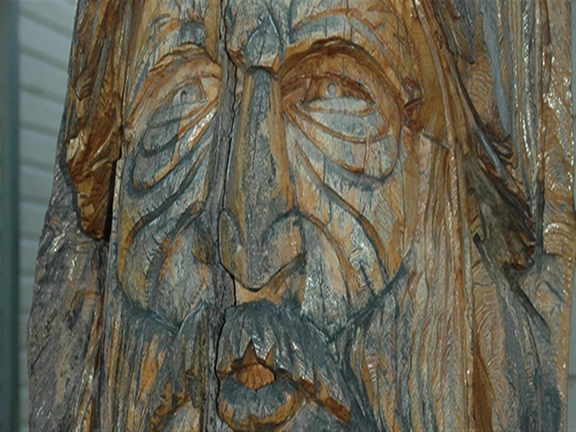 Tree carving of an old man.