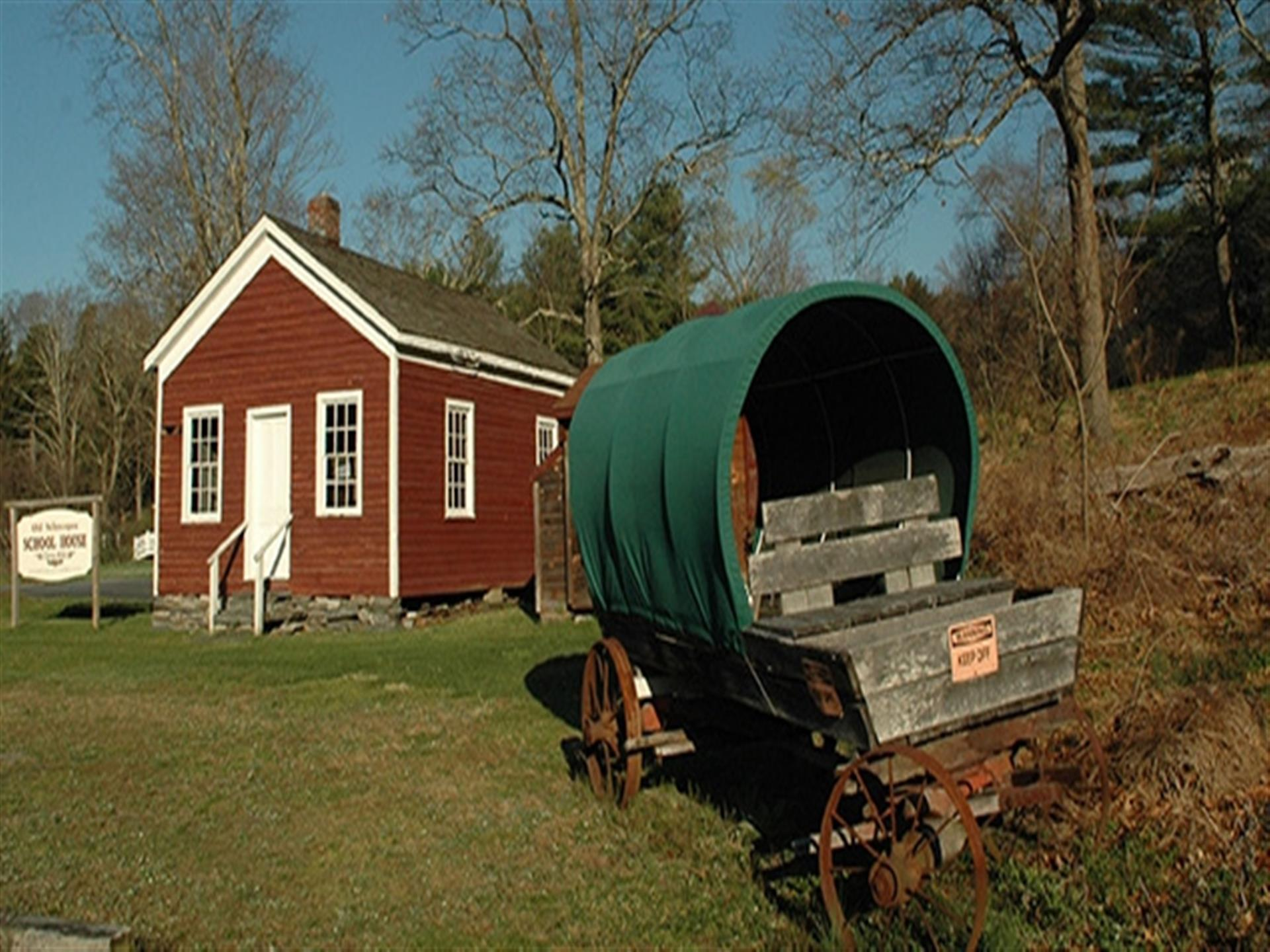 Vintage wagon next to Old Schoepee School House.