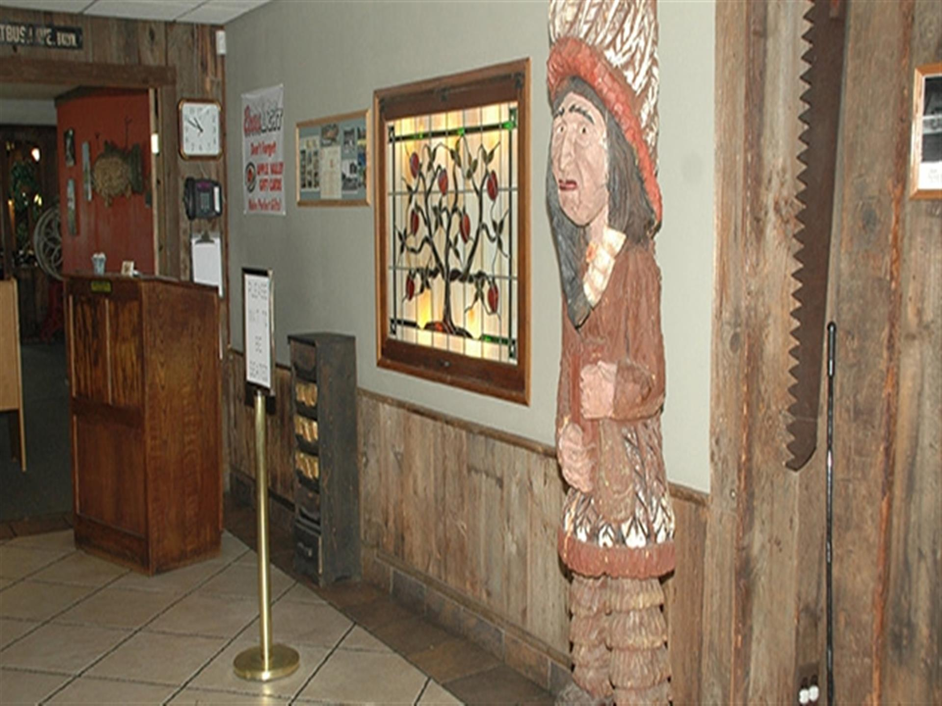 front entrance at Apple Valley Restaurant. Wood walls . Native American wall decor.