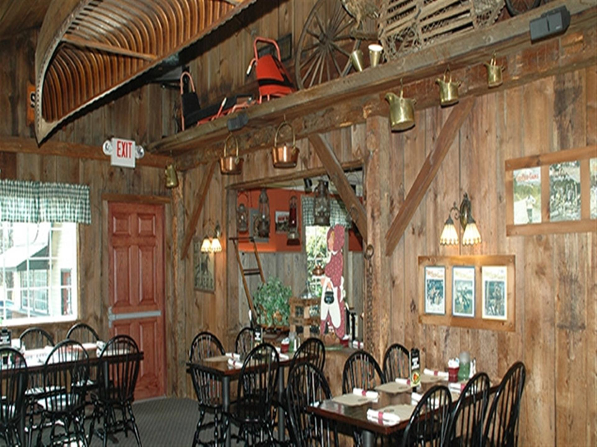 Inside the dining room at Apple Valley Restaurant.Wood walls and tables. Native American wall decor.