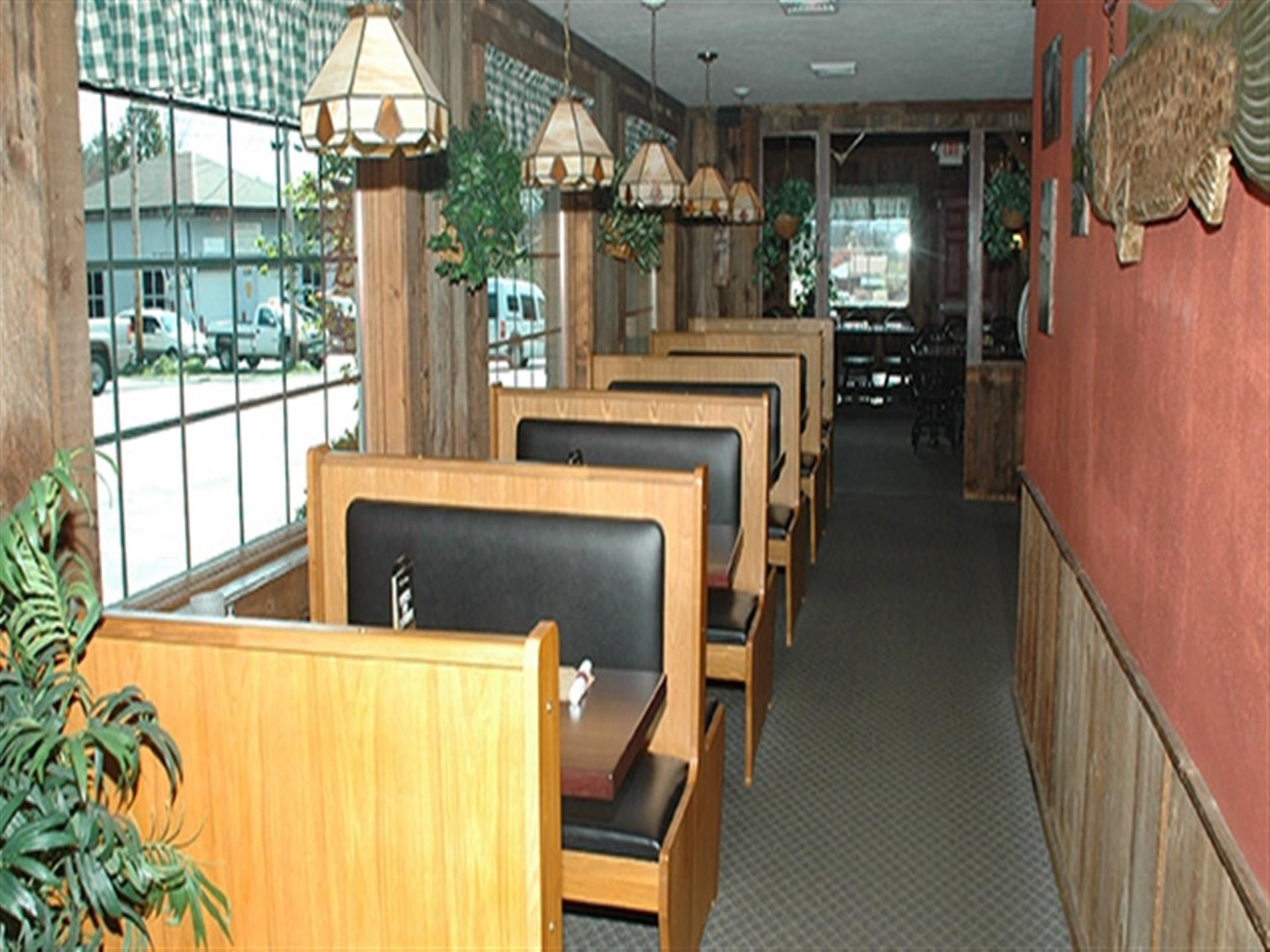 Inside the dining room at Apple Valley Restaurant. Booths by the window.