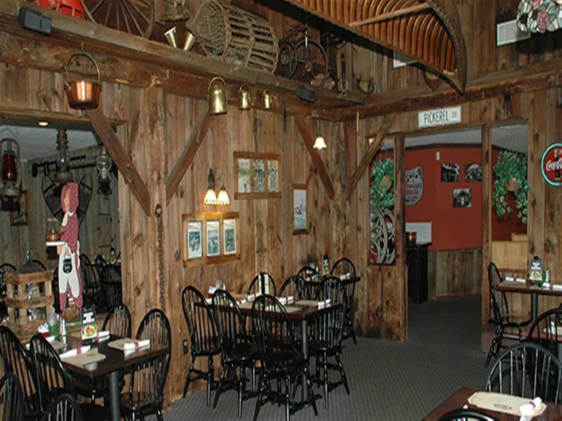 Inside the dining room at Apple Valley Restaurant. Country log cabin vibe. Wood walls and tables. Native American wall decor.