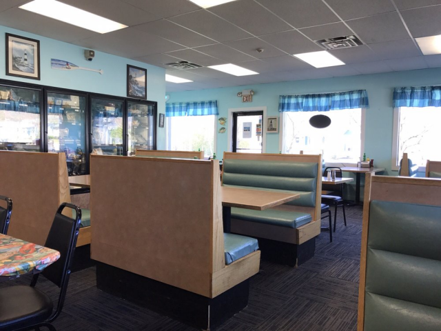 Interior dining area with booths and tables