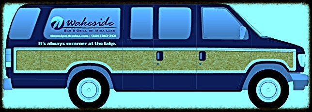 Side profile of a van with Wakeside Bar and Grill branding