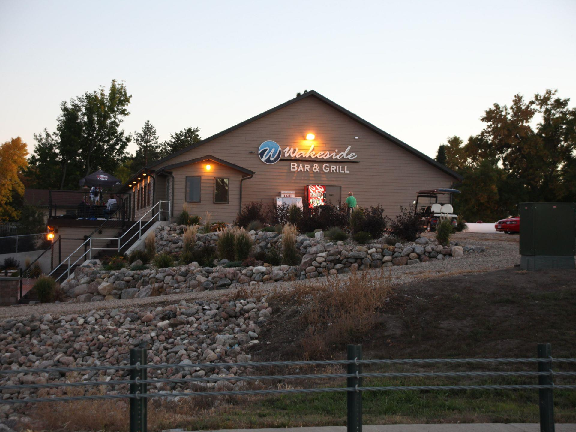 Exterior of Wakeside Bar and Grill with a rock pathway leading around the building