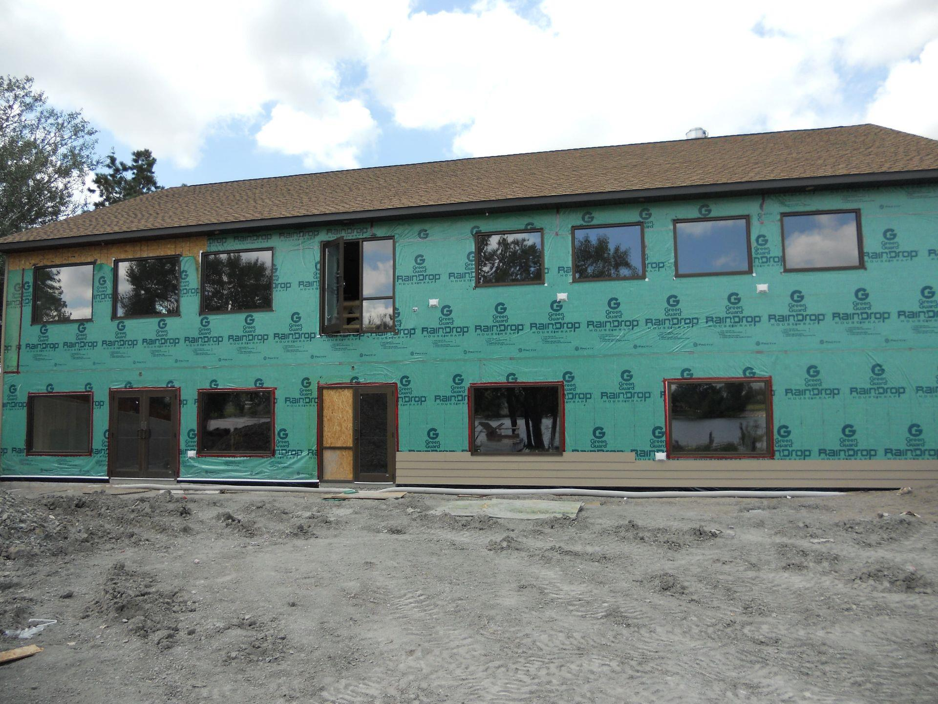 Exterior of building under construction with pre-siding