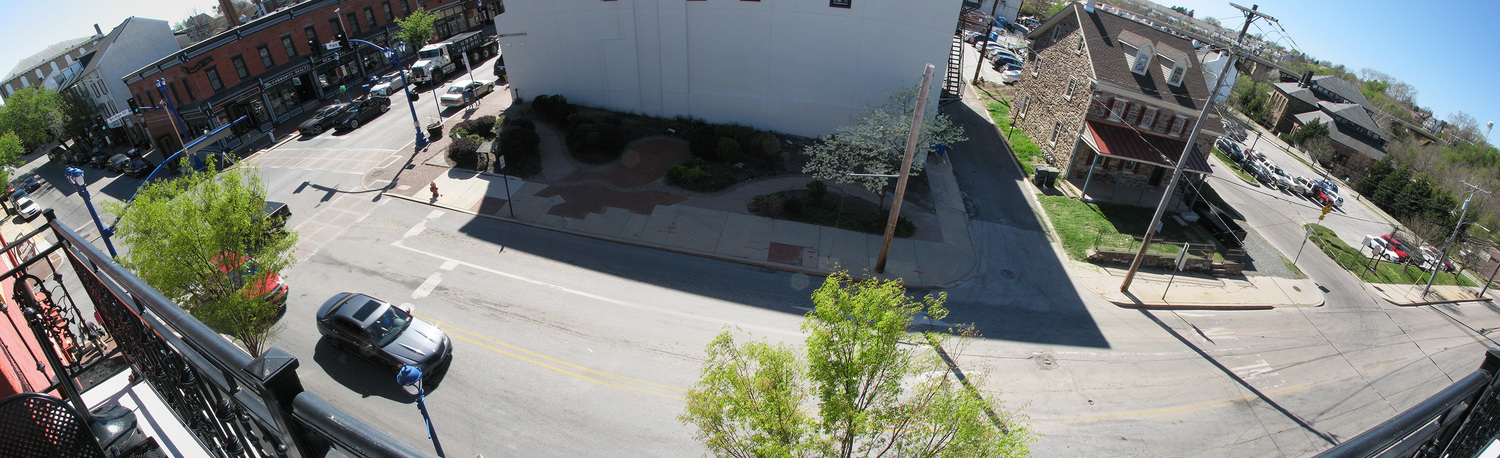 View from molly's rooftop showing street below and surrounding buildings.