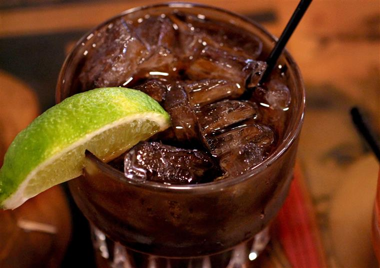 Captain and Coke garnished with lime.
