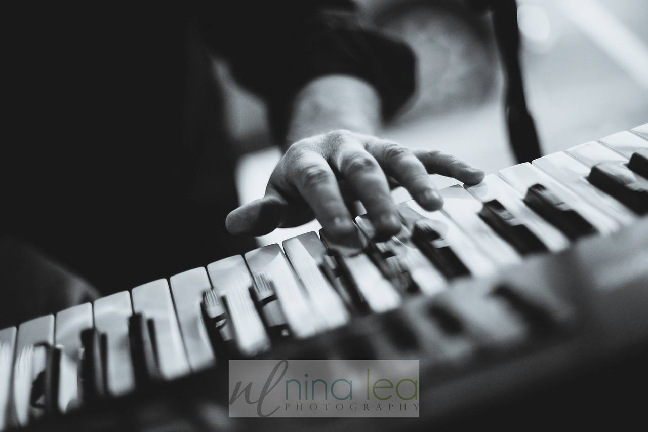 Black and white image of man playing the piano