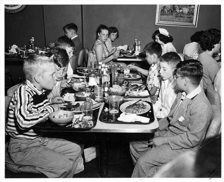People eating at tables in restaurant