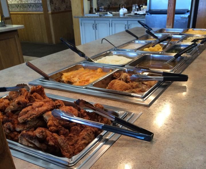 Lunch buffet display complete with fried chicken, macaroni and cheese, mashed potatoes, vegetables and much more.