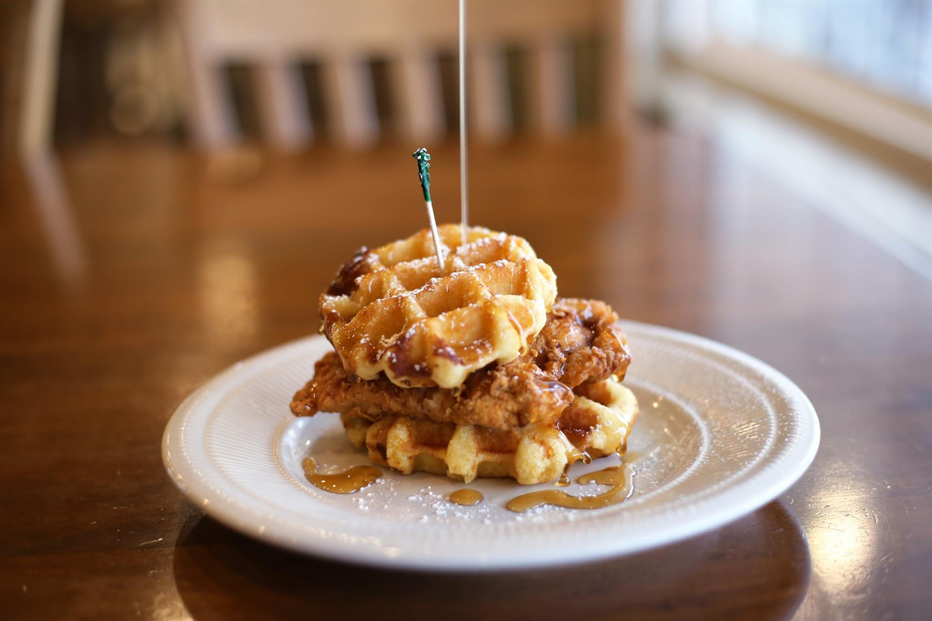 fried chicken with waffles as the buns on a plate
