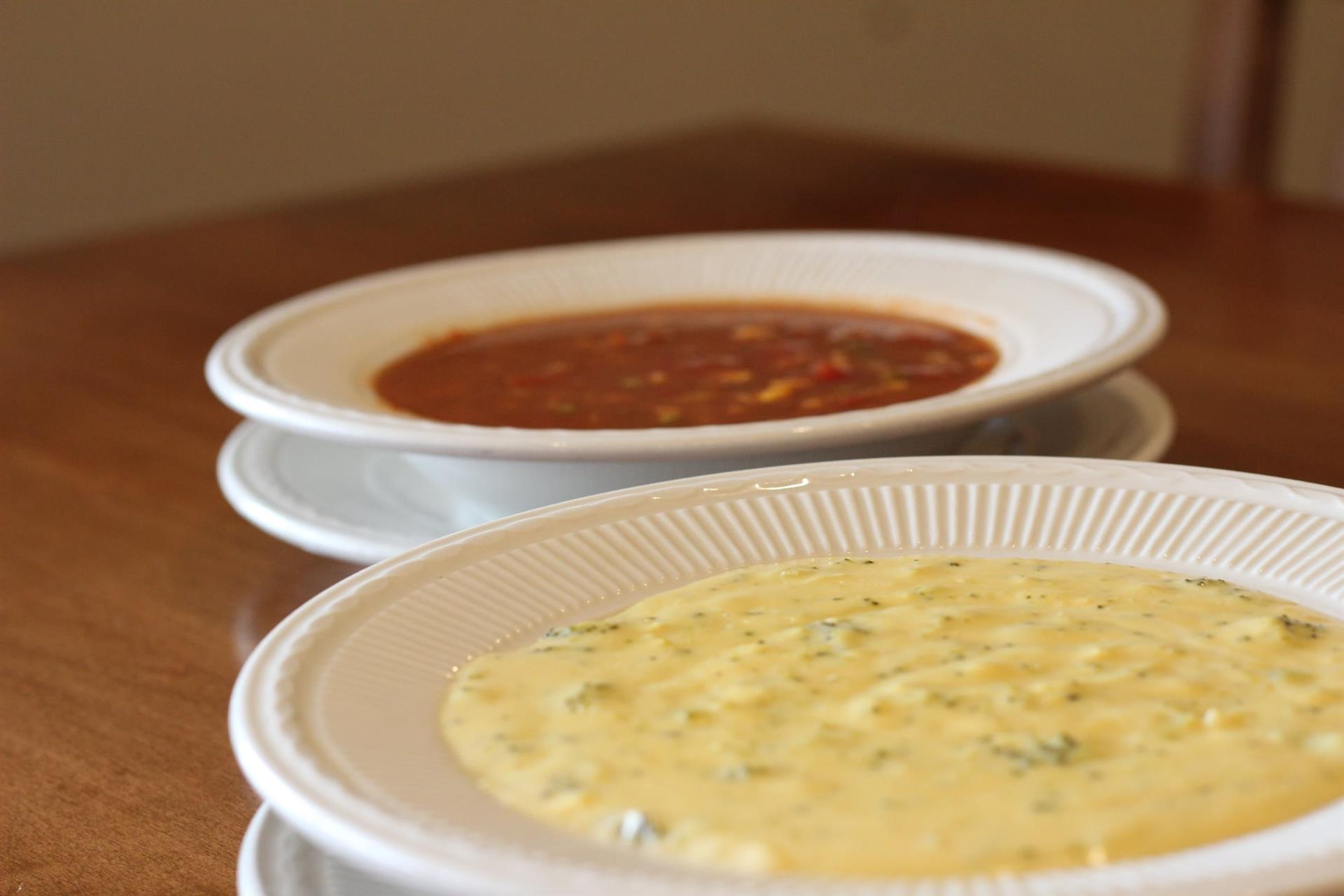 2 different types of soups in 2 bowls