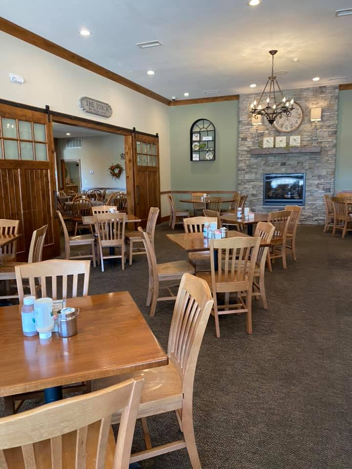 Dining area inside Yoder's Kitchen with tables and chairs