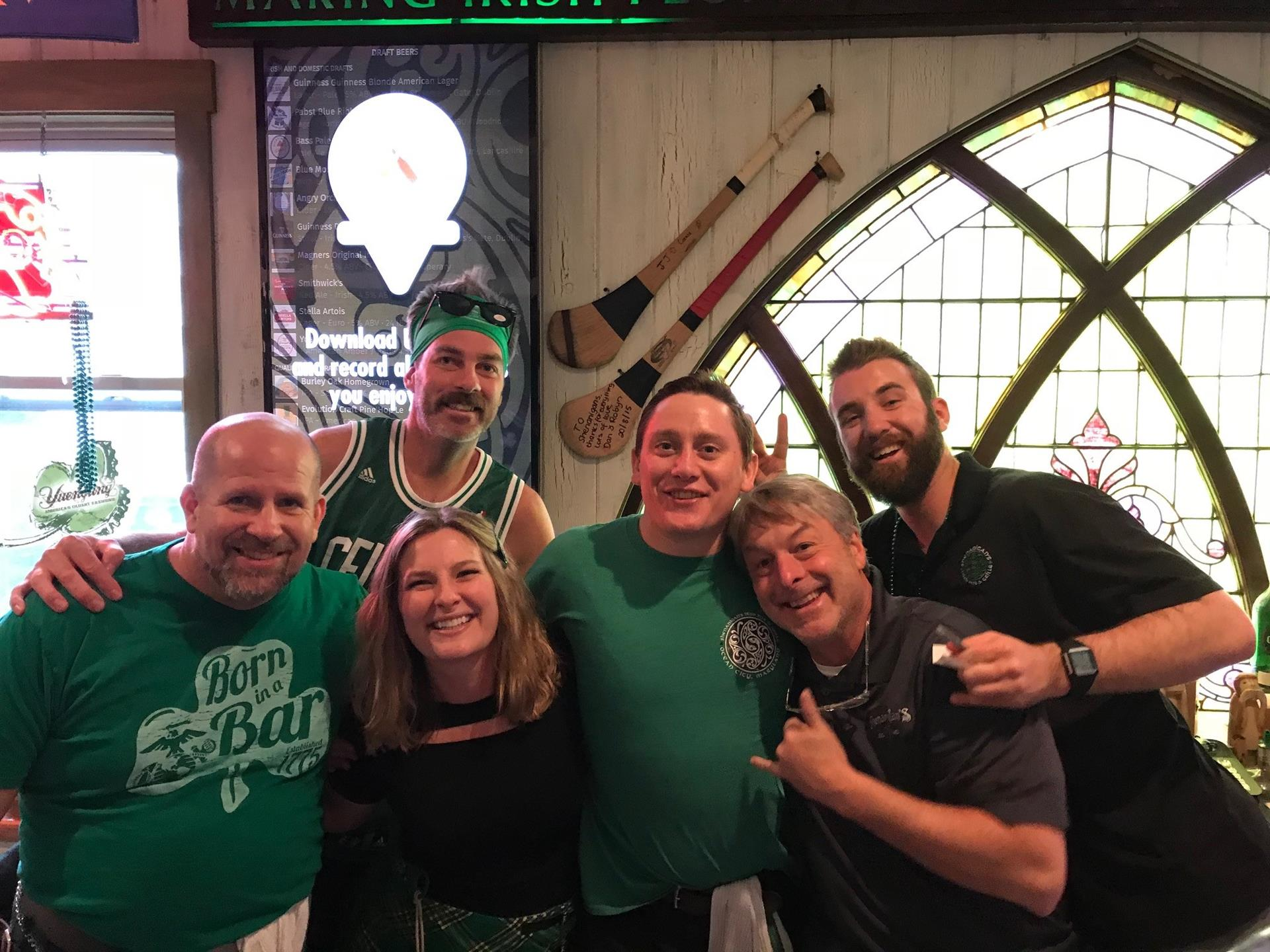 Six staff members at Shenanigans smiling and wearing green on St Patrick's Day 2018