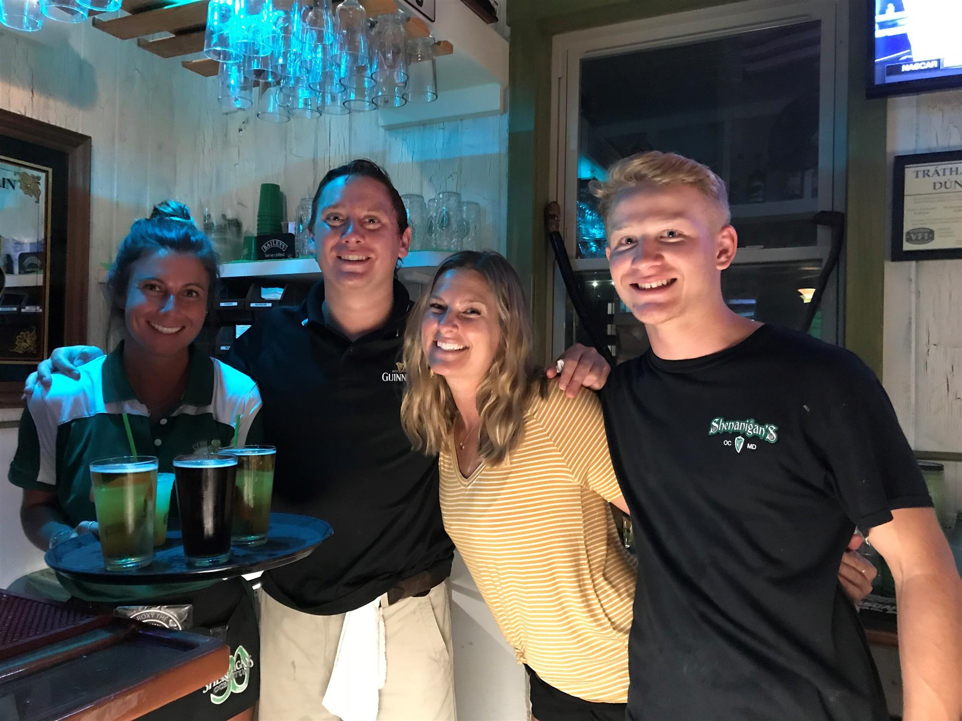 Employees smiling and working at the bar