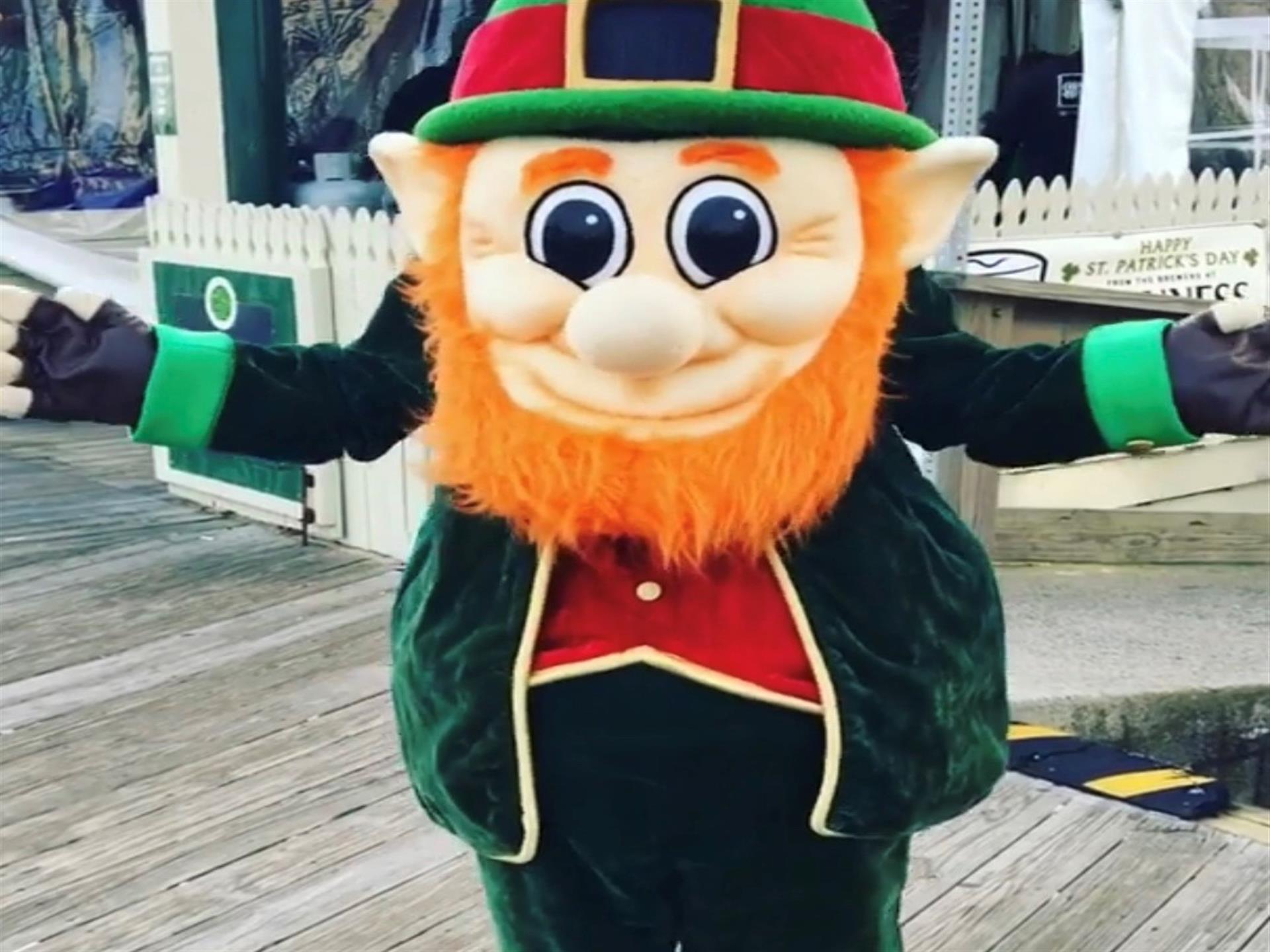 Leprechaun mascot outside on the boardwalk.