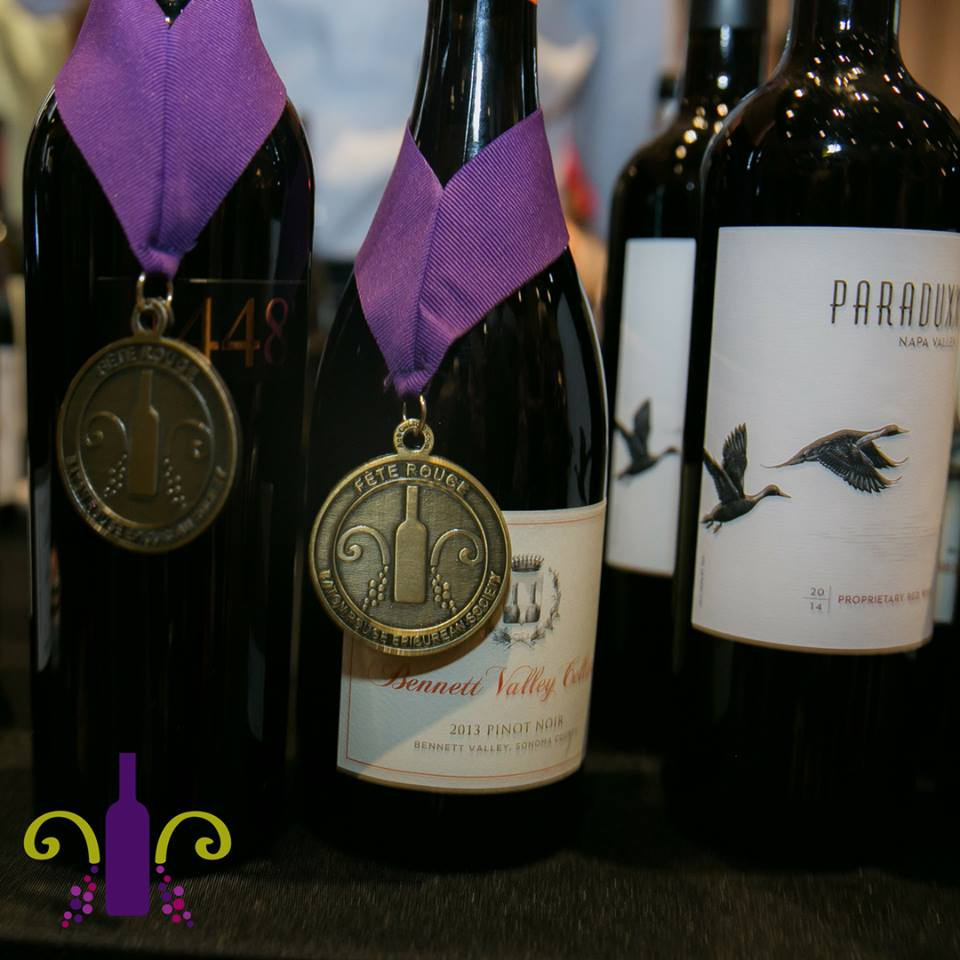 wine bottles with medal hanging on the neck
