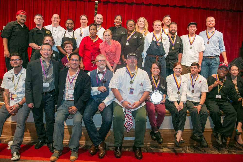 2017 Chef's Competition Winners sitting and standing on a stage for a photo