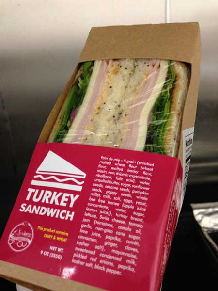 Turkey Sandwich wrapped in plastic in carboard box