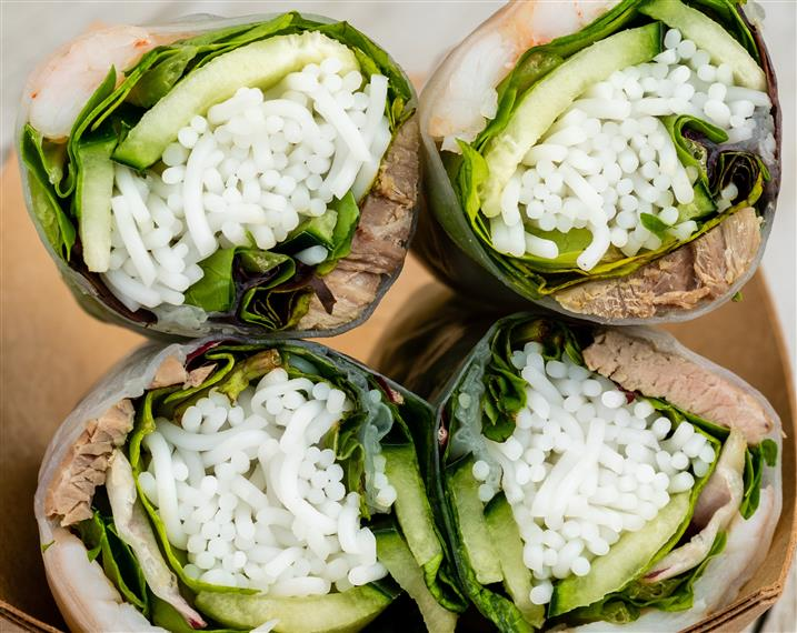 Beef, lettuce, cucumber, and white rice wrap close up