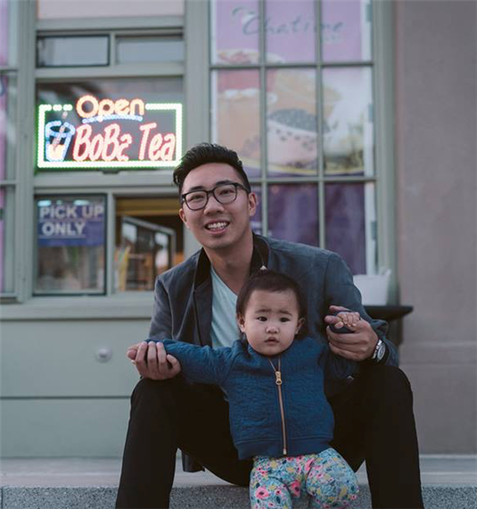 a picture of Desmond Wong and a little girl