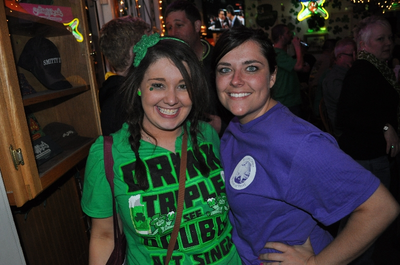 Two females wearing St. Patrick's Day attire smiling