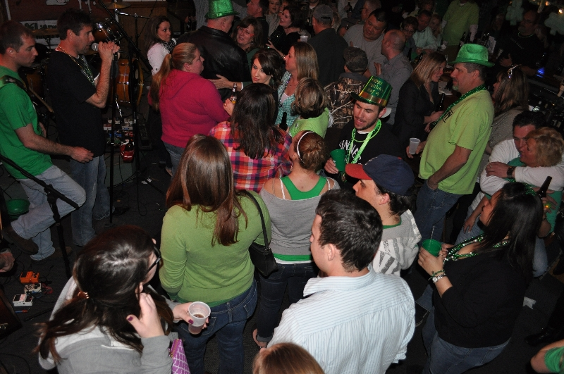 Large group in a bar setting dancing